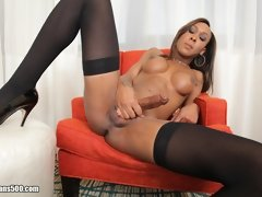 Transsexual Kayla Biggs enjoys herself some solo playtime masturbation just for us!