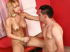 Pretty and busty shemale gets pleasured and nailed by a stud