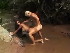 Gorgeous mulatto TS fucks in jungle