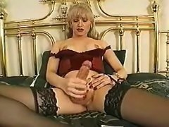 Horny mature shemale jizzing on bed