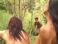 Guy joins shemales sexing in forest